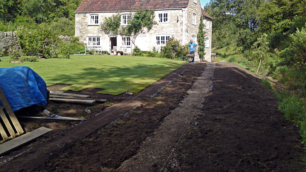 new turf being laid after levelling the ground