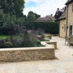 cotswold drystone wall incorporates lighting