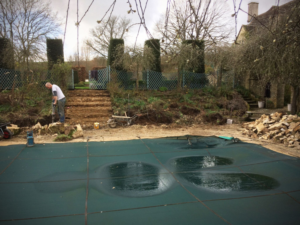 Preparing the land to build cotswold stone retaining walls and steps. Ground preparation for slabs to be laid around swimming pool.