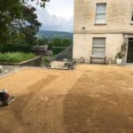 laying the self-binding gravel driveway